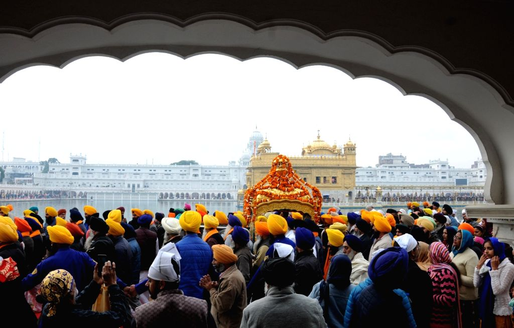 Sikh devotees participate in 'Nagar Kirtan' procession near Golden Temple organised on the eve of the 338th birth anniversary of Sikh warrior Shaheed Baba Deep Singh in Amritsar on Jan 25, ... - Baba Deep Singh