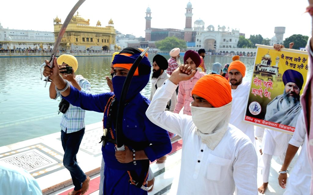 Sikh devotees pay respects on the occasion of the 37th anniversary of the Operation Blue Star, 1984, at Golden Temple in Amritsar on Sunday, June 6, 2021.