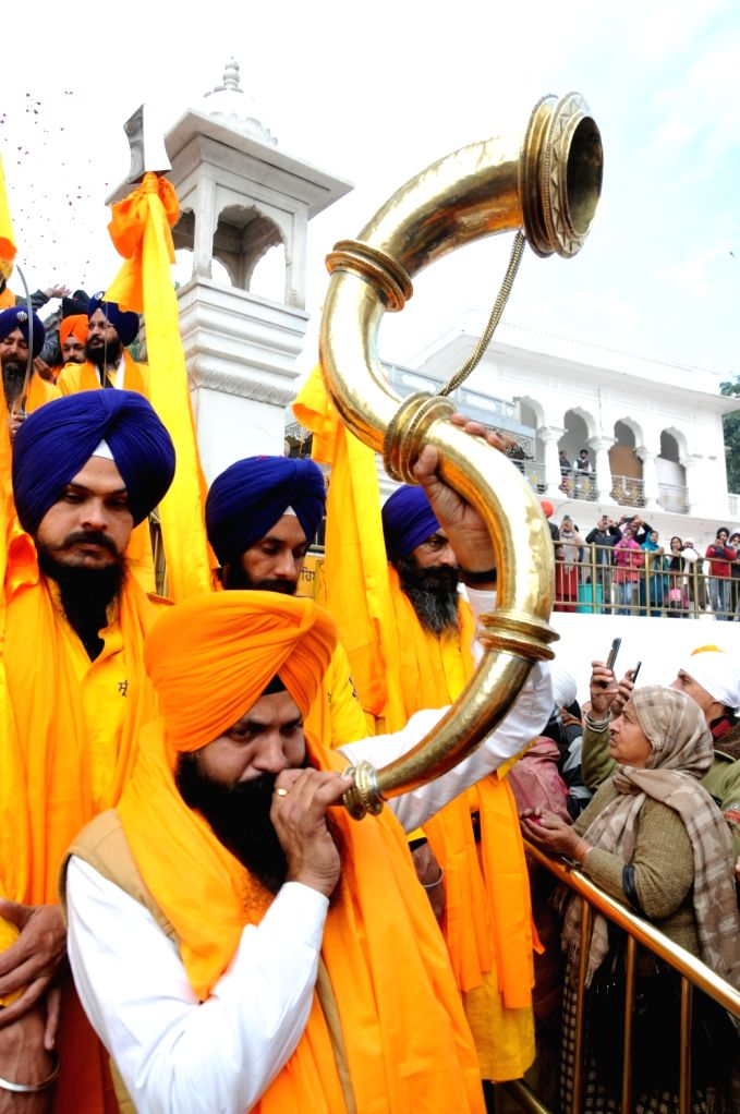 Sikh devotees perform martial arts 'Gatka' during 'Nagar Kirtan' procession near Golden Temple organised on the eve of the 338th birth anniversary of Sikh warrior Shaheed Baba Deep Singh in ... - Baba Deep Singh