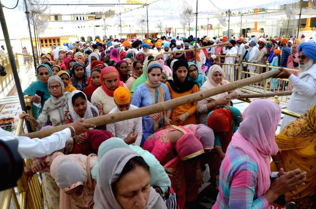 Sikh devotees visit the Golden Temple on the occasion of Baisakhi festival in Amritsar on Tuesday April 13th, 2021.