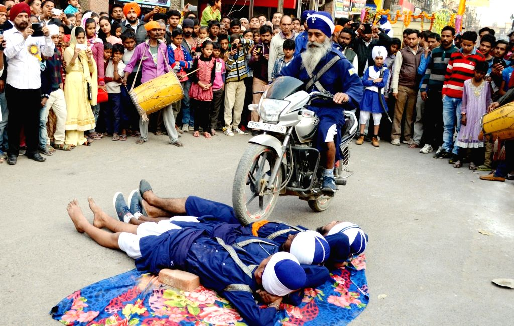Sikh nihangs demonstrate their skills during a religious procession in Allahabad, on Jan 14, 2016.