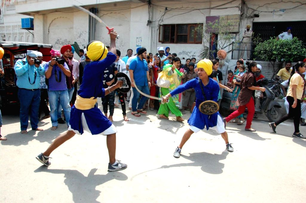 Sikh Nihangs demonstrate their skills on the eve of Guru Tegh Bahadur's birth anniversary at Golden Temple in Amritsar, on April 4, 2018.