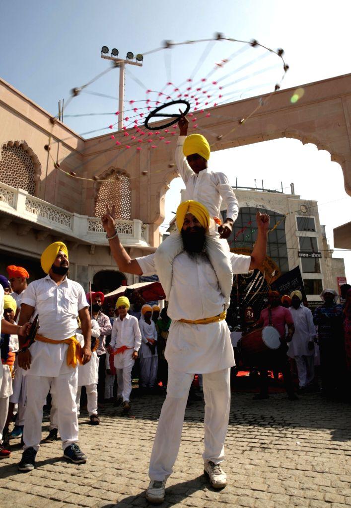 Sikh Nihangs display their 'Gatka' skills on the eve of the birth anniversary of Forth Sikh Guru Ramdass Ji (Founder of Amritsar City) in Amritsar on Oct 15, 2016.