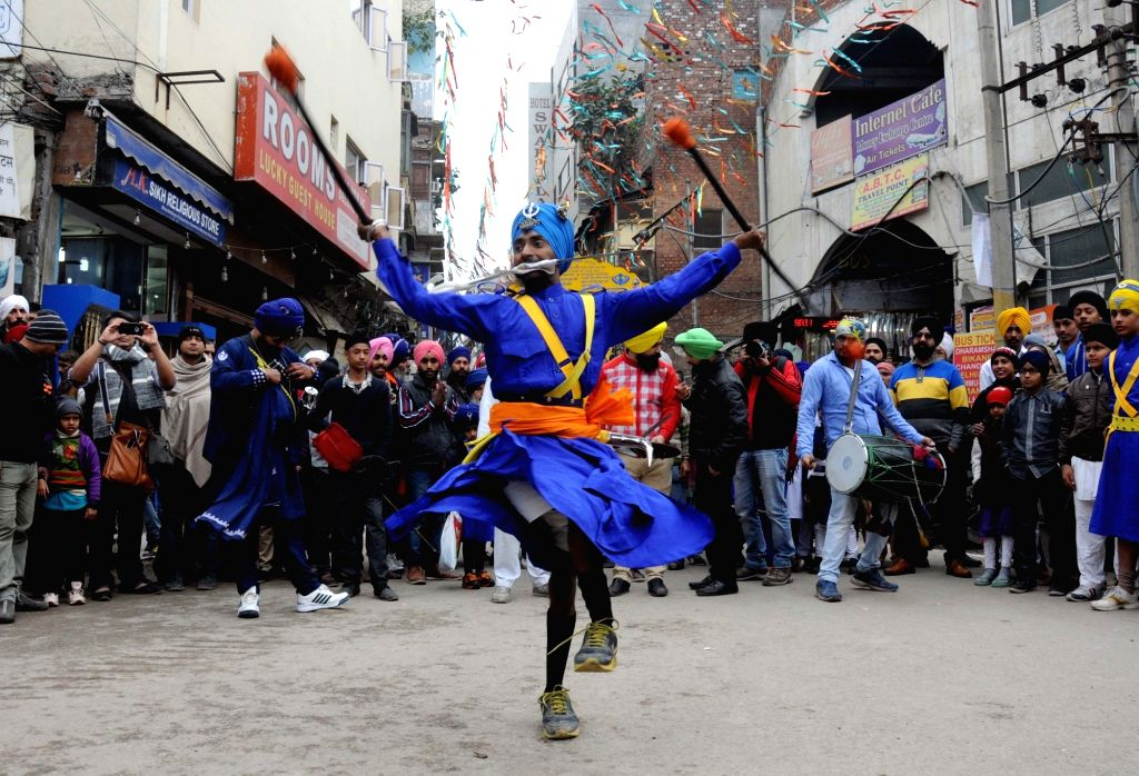 Sikh nihangs display their skills during a Nagar Kirtan organised on the eve of the birth anniversary of the 10th Sikh Guru Gobind Singh in Amritsar, on Jan 15, 2016.