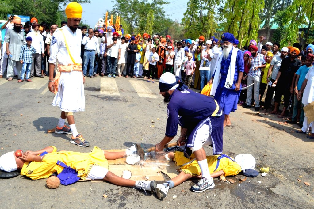 Sikh nihangs display their skills religious procession organised to mark 317 years of Khalsa in Guwahati, on April 12, 2016.