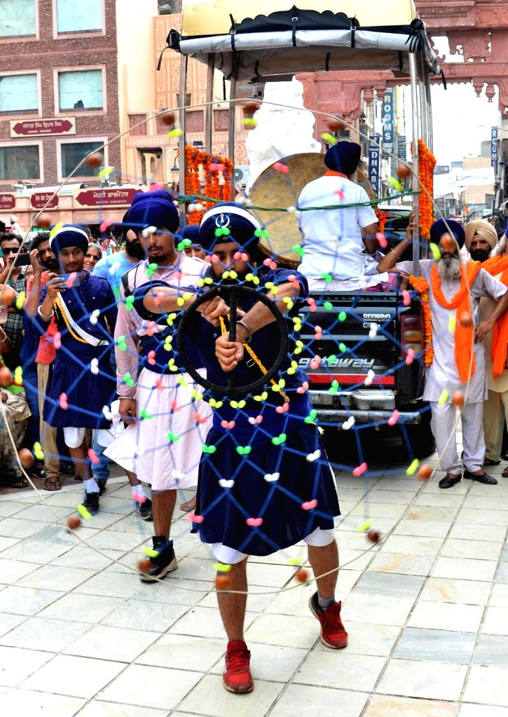 Sikh 'nihangs' perform 'gatka' during  'Nagar Kirtan' (religious procession) that is on its way to the Dera Baba Nanak in Punjab's Gurdaspur district, organised to mark the 550th birth ... - Nanak Dev