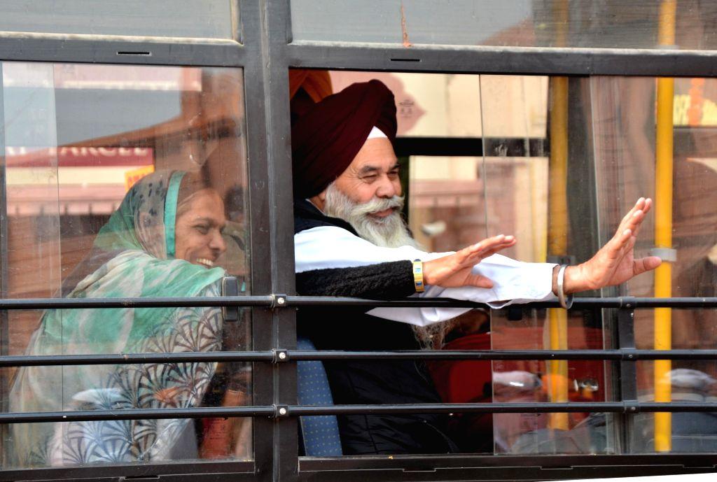 Sikh pilgrims leaving for Gurdwara Nankana Sahib in Pakistan to celebrate the 548th birth anniversary of Sri Guru Nanak Dev in Amritsar on Nov. 12, 2016.