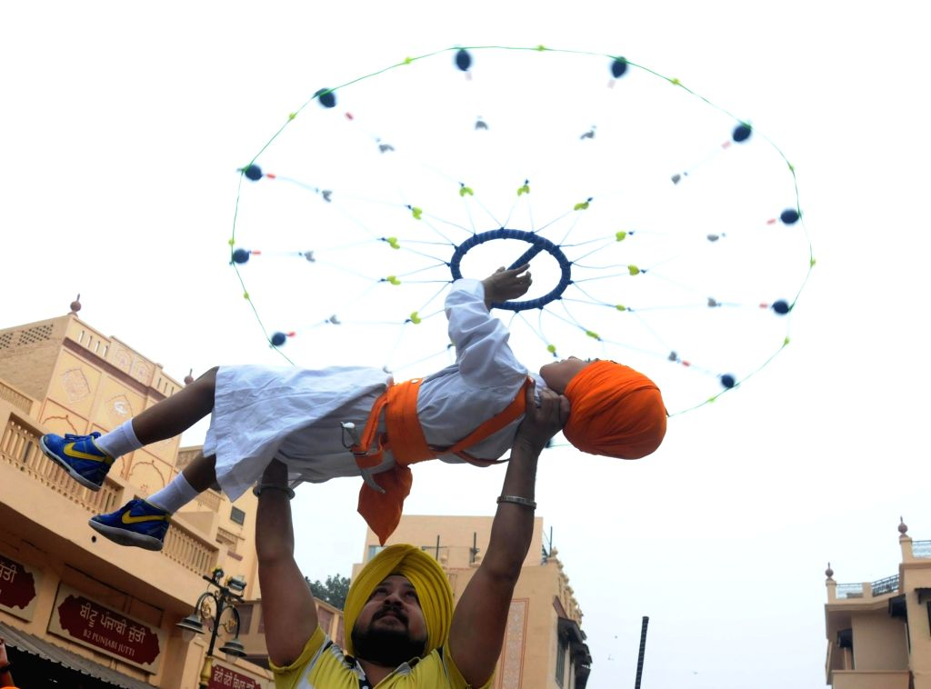 Sikh students performs Gatka during Nagar Kirtan (procession) near the  Golden Temple ahead of 548th birth anniversary of Sri Guru Nanak Dev in Amritsar on Nov. 12, 2016.