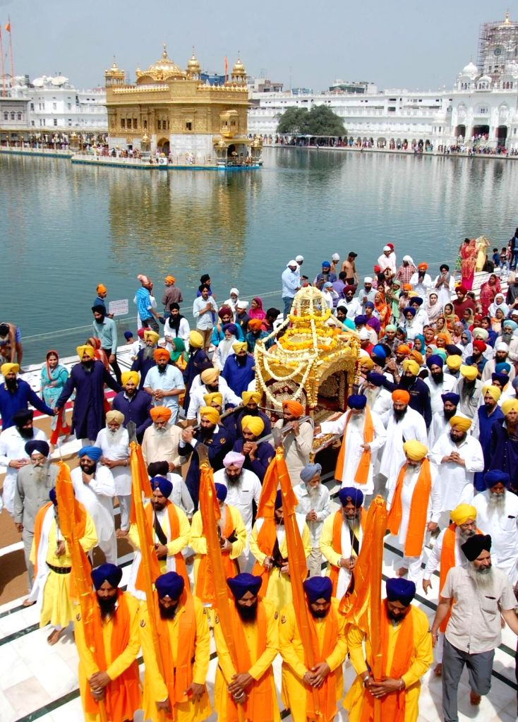 Sikhs participate in a Nagar Kirtan on the eve of Guru Tegh Bahadur's birth anniversary at Golden Temple in Amritsar, on April 4, 2018.