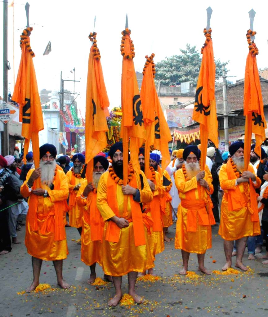 Sikhs participate in a Nagar Kirtan organised on the eve the birth anniversary of the 10th Sikh Guru Gobind Singh in Patna, on Jan 15, 2016.
