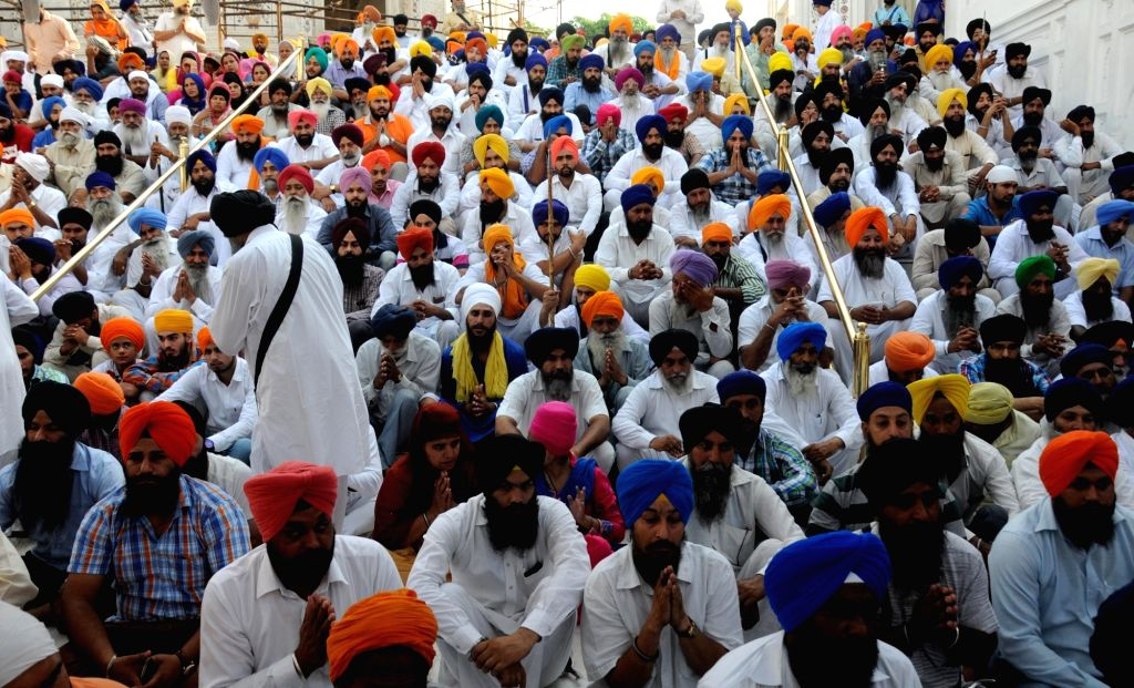 Sikhs participate in a prayer meeting for those killed during Operation Bluestar in Amritsar on June 6, 2016.