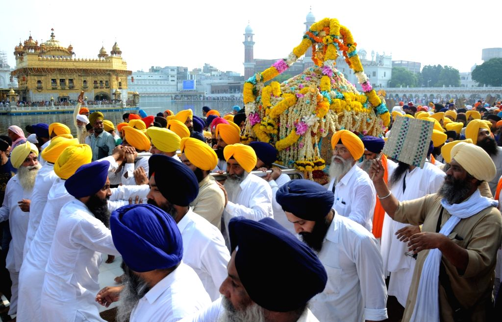 """Sikhs participate in a procession organised at the Golden Temple on """"Parkash Purab of Sri Guru Granth Sahib"""" in Amritsar on Sept 10, 2018."""