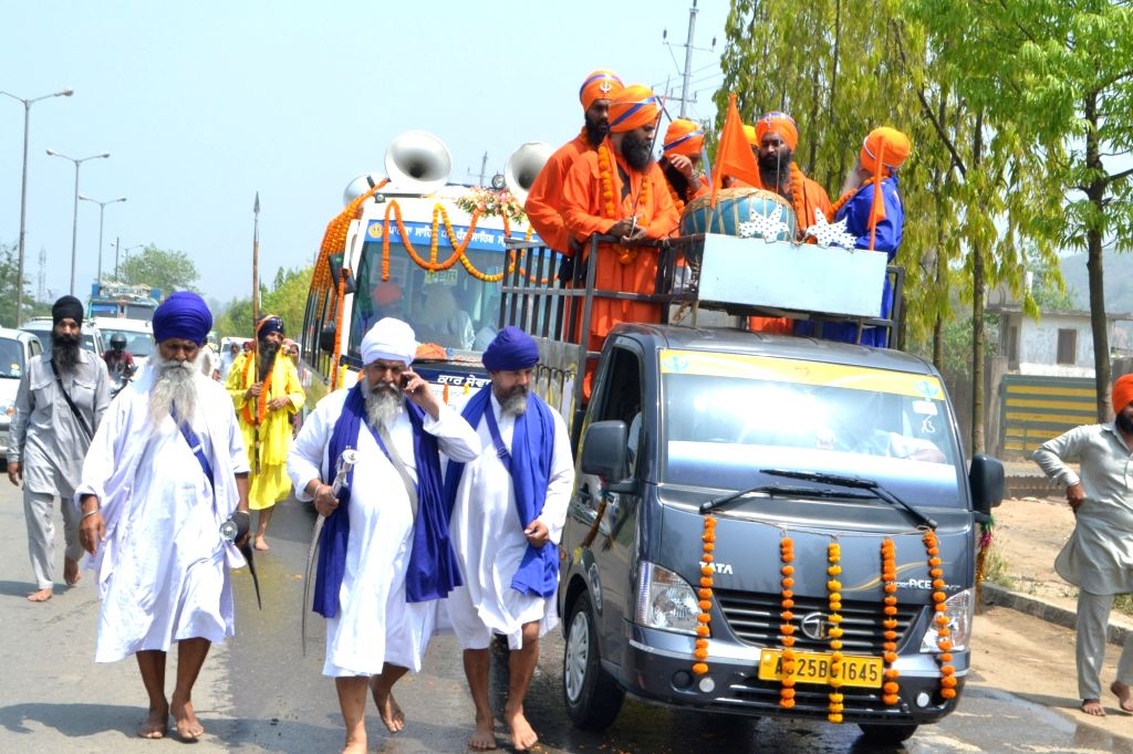 Sikhs participate in a religious procession organised to mark 317 years of Khalsa in Guwahati, on April 12, 2016.