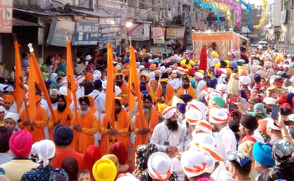 Sikhs participate in a religious procession organsied on the marriage anniversary of Guru Nanak Dev at Batala some 45 km away from Amritsar on Sept 16, 2018. - Nanak Dev
