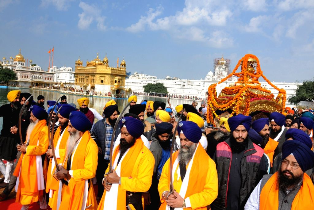Sikhs participate in a religious procession organised on the eve of martyrdom day of Guru Tegh Bahadur at the the Golden Temple in Amritsar on Dec 11, 2018.