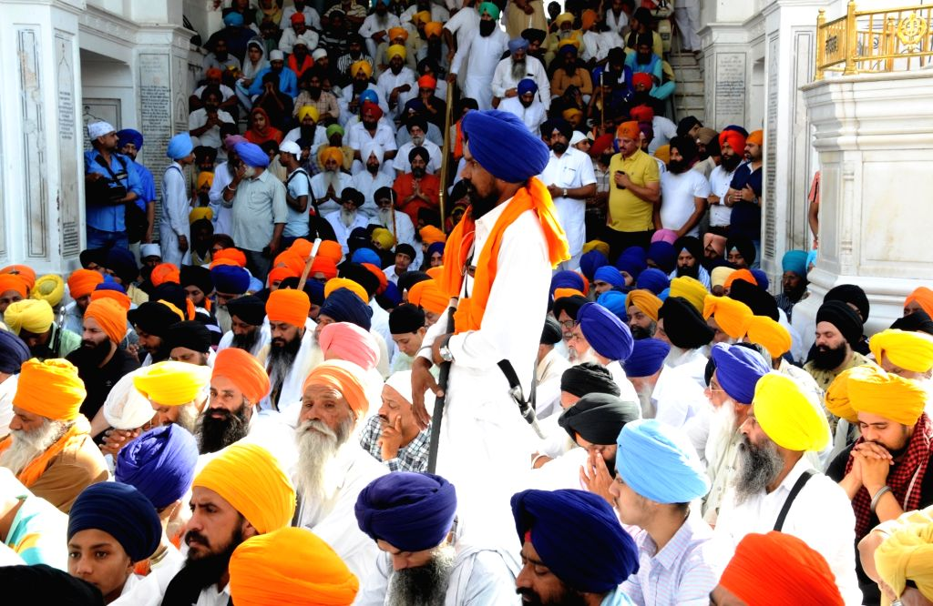 Sikhs pray during ???genocide remembrance march??? organised by the Shiromani Gurdwara Parbandhak Committee on the 35th anniversary of Operation Bluestar, at the Golden Temple in Amritsar ...