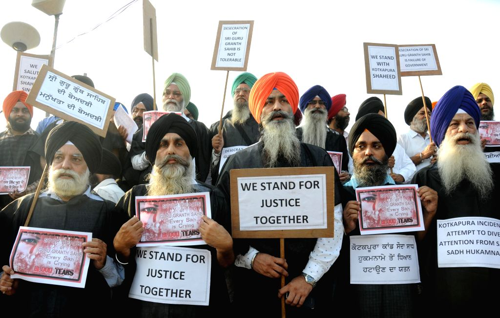 Sikhs protest against desecration of their holy book in  Amritsar on Oct 15, 2015.