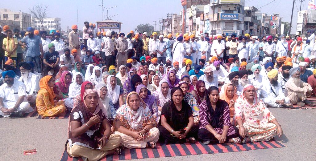 Sikhs protest against desecration of their holy book - Guru Granth Sahib in Moga of Punjab on Oct 15, 2015.