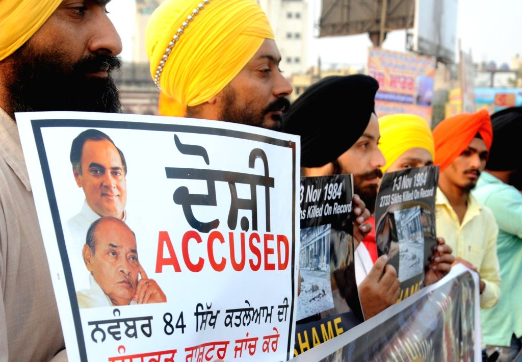 Sikhs stage a demonstration to demand justice for the victims of 1984 anti-sikh riots in Amritsar, on Nov 2, 2015.