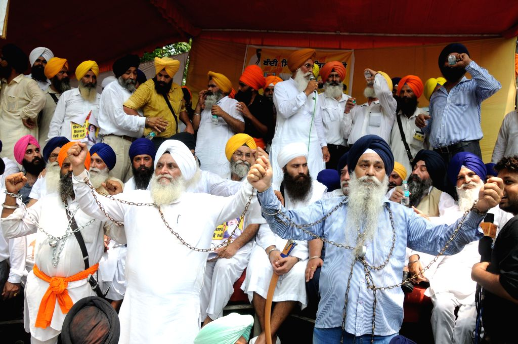 Sikhs stage a demonstration to press for the release of Sikh political prisoners lodged in different jails across India, at Jantar Mantar in New Delhi on Aug 4, 2015.