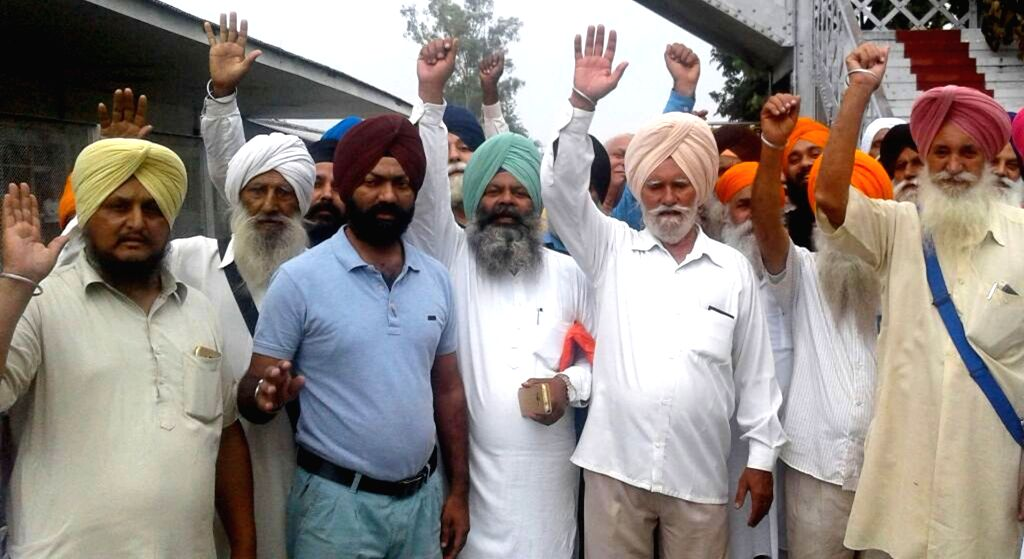 Sikhs, stranded at the Attari railway station near Amritsar amid heavy rain stage a demonstration against Union Government after a special train from Pakistan that was to ferry them to that ... - Ranjit Singh