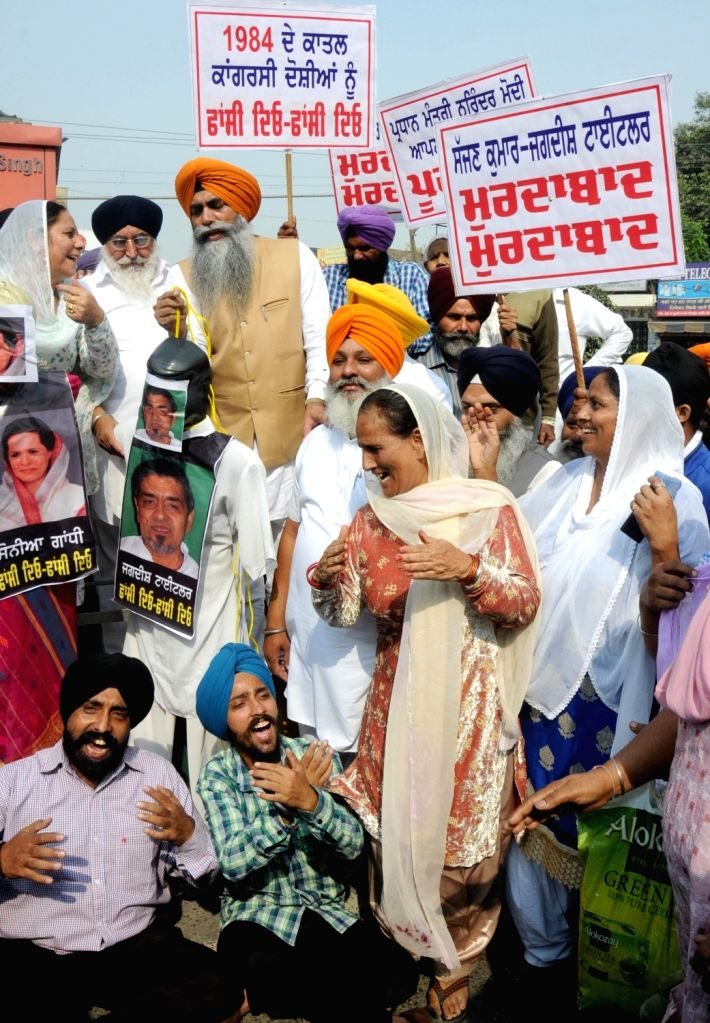 Sikhs under the banner of 1984 Sikh Katlaeam Peerit Welfare Society stage a demonstration to demand justice for the victims of 1984 anti-sikh riots in Amritsar, on Nov 2, 2015.