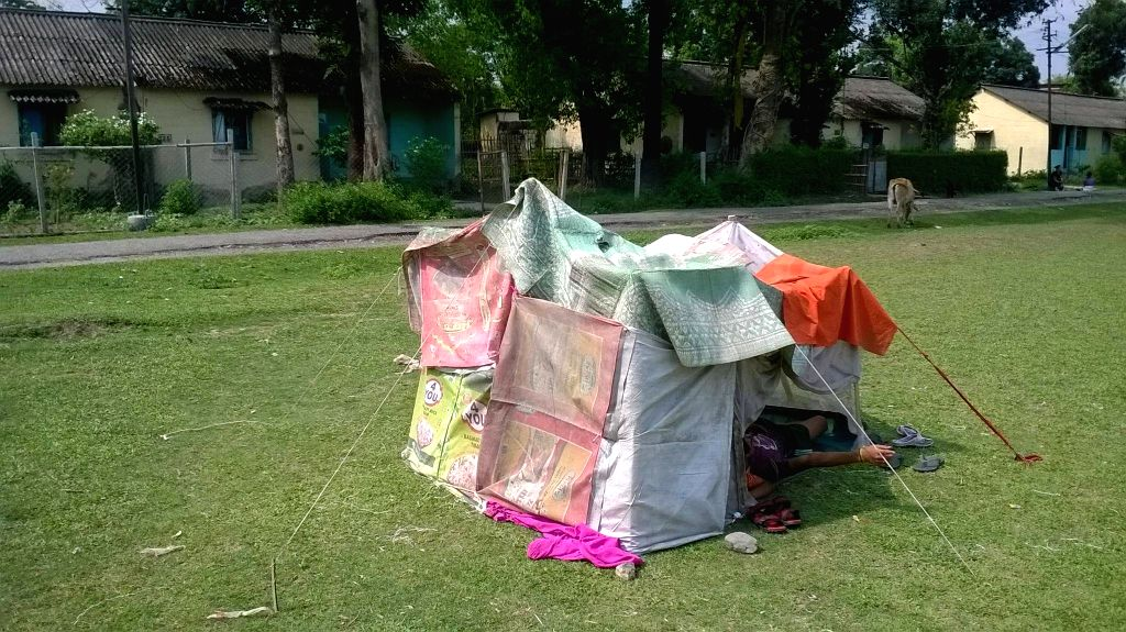 A makeshift tent setup by locals in an open ground of Siliguri, in the wake of earthquakes, on April 27, 2015.