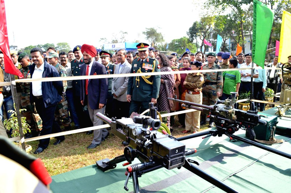 Indian athletics legend Milkha Singh with West Bengal Urban Development Minister Firhad Hakim and others at the inauguration of an arms exhibition in Siliguri, on Dec 16, 2014. - Firhad Hakim