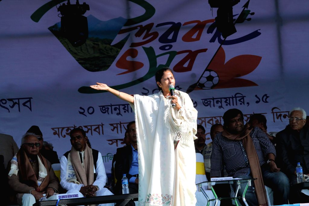 West Bengal Chief Minister Mamata Banerjee addresses during the Uttar Banga Utsav in Siliguri on Jan 20, 2015.