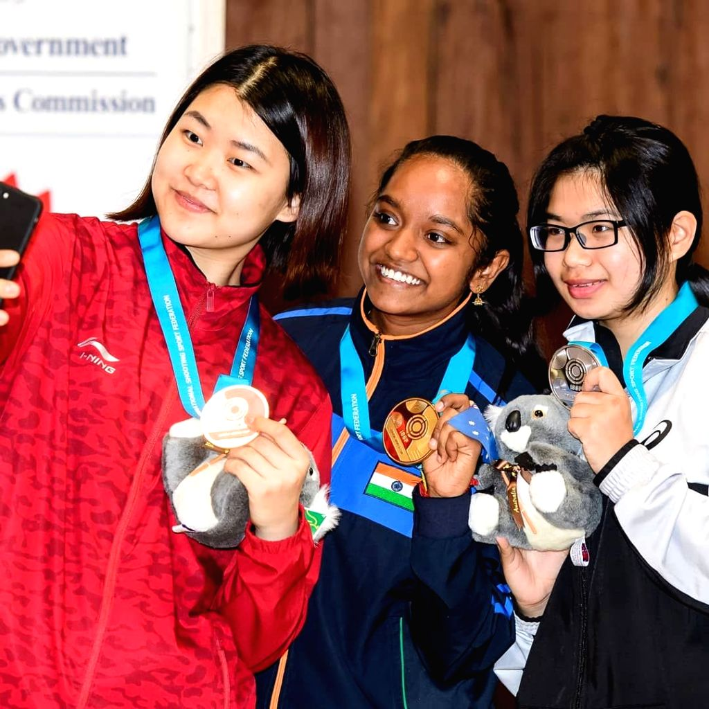Silver medalist Lin Ying-Shin of China, Gold medalist Elavenil Valarivan of India and Bronze medalist Wang Zeru of China pose with their medals after the ISSF Junior World Cup at the Sydney ...