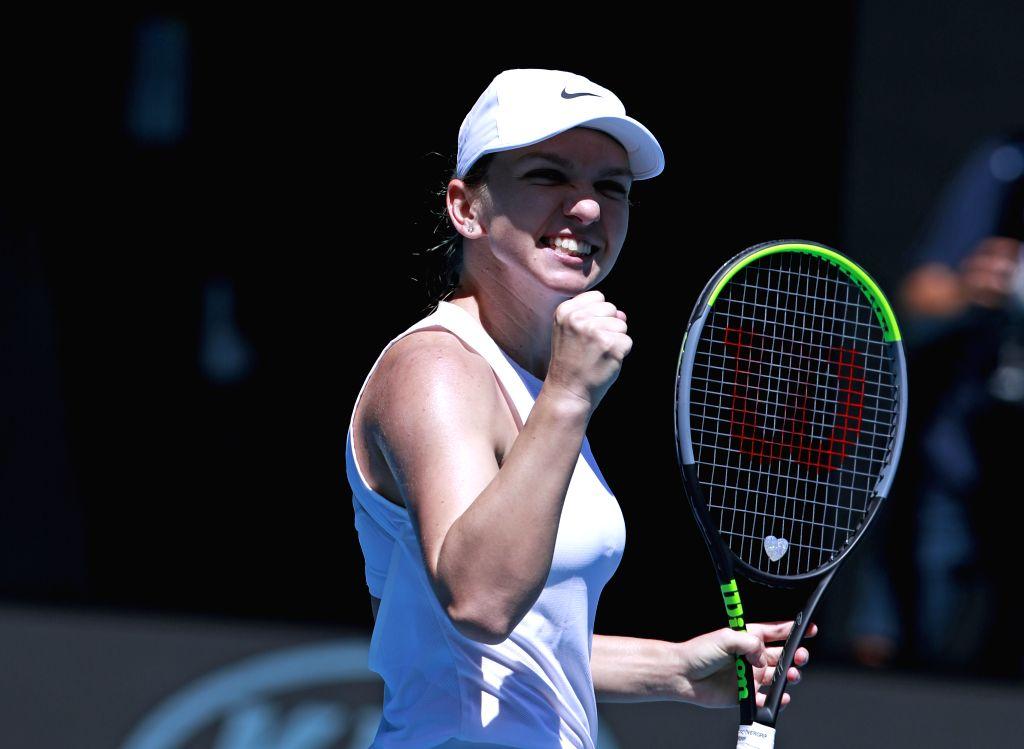Simona Halep of Romania celebrates after winning the women's singles match between Simona Halep of Romania and Anett Kontaveit of Estonia at the Australian Open ...