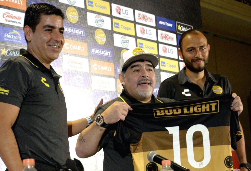 "SINALOA, Sept. 11, 2018 - Diego Maradona (C), holds a jersey of the Mexican soccer team ""Dorados de Sinaloa"" during a press conference to be presented as new head coach, in the city of ..."