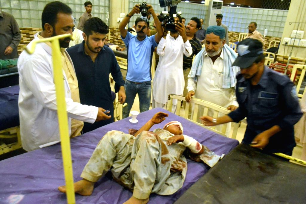 SINDH, July 16, 2018 - An injured boy receives medical treatment at a hospital in Hyderabad, Pakistan, on July 16, 2018. At least 17 people were killed and 13 others injured when a truck hit into a ...