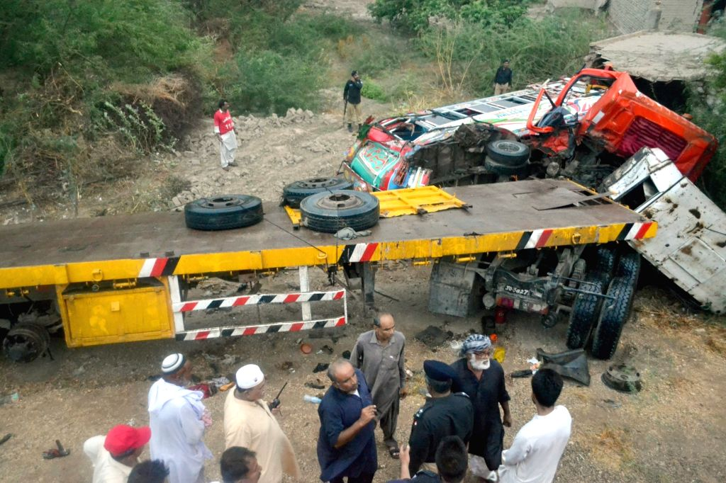 SINDH, July 16, 2018 - People gather at the accident site in Matiari area of the southern Pakistan's Sindh province on July 16, 2018. At least 17 people were killed and 13 others injured when a truck ...