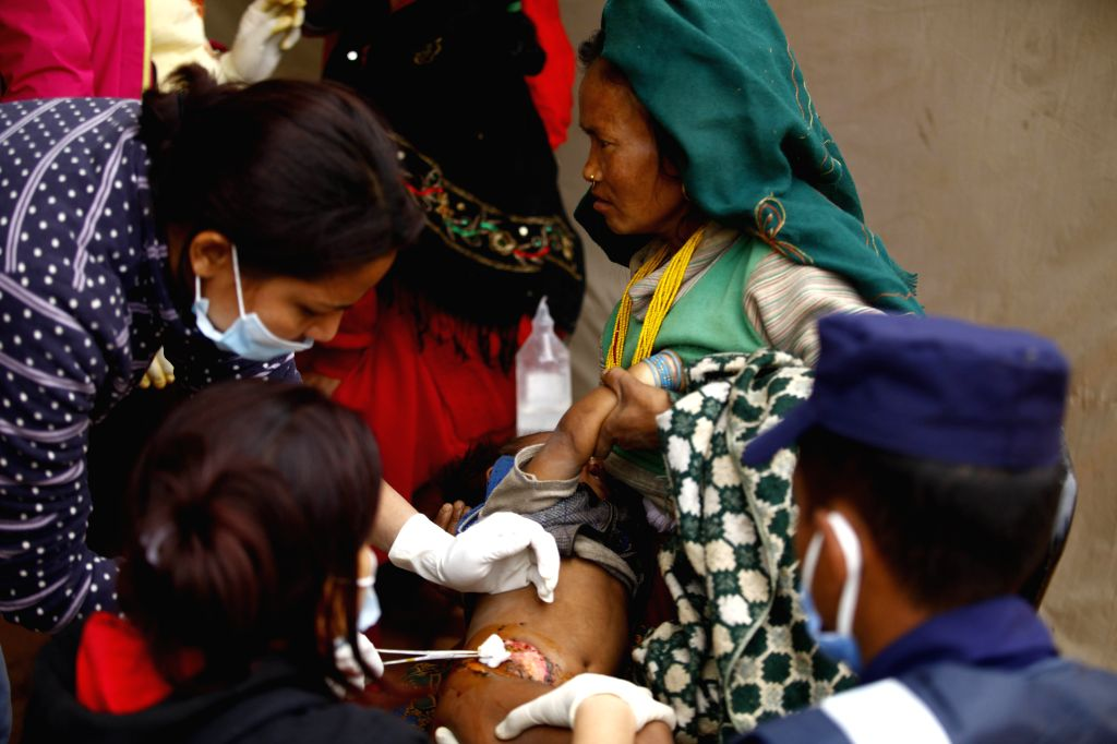 An injured child is treated by a doctor in Sindhupalchowk district, Nepal, April 29, 2015. By noon on Wednesday, more than 1,376 people had already been ...
