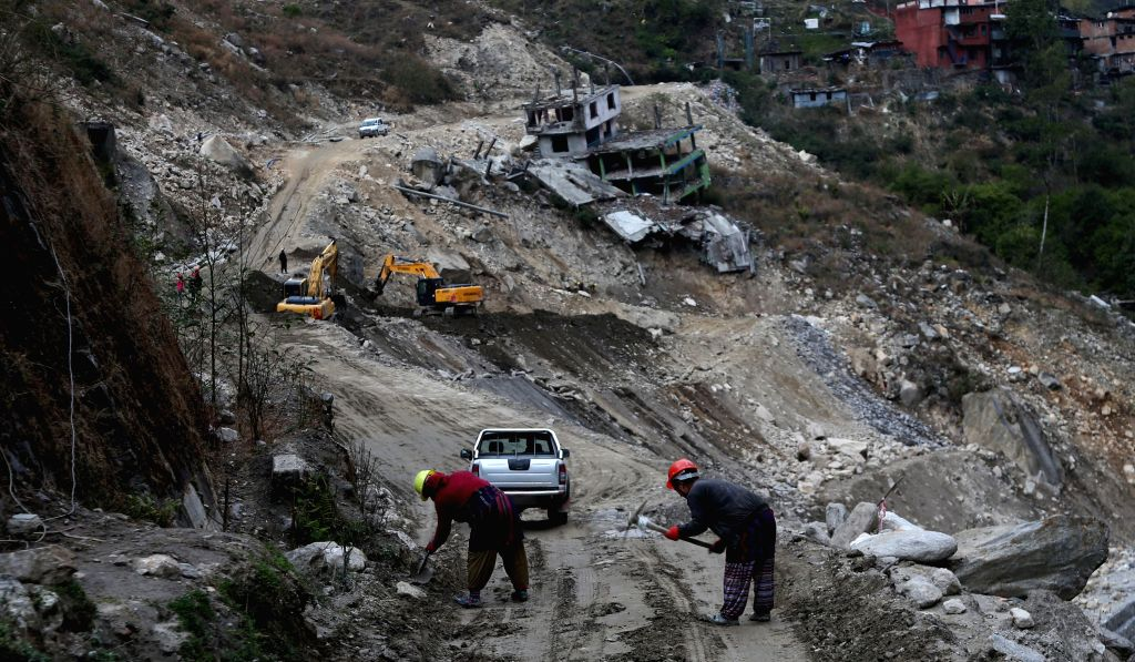 SINDHUPALCHOWK, Feb. 20, 2019 - Workers are seen at a construction site of the Araniko Highway in Sindhupalchwok, Nepal, Feb. 18, 2019.