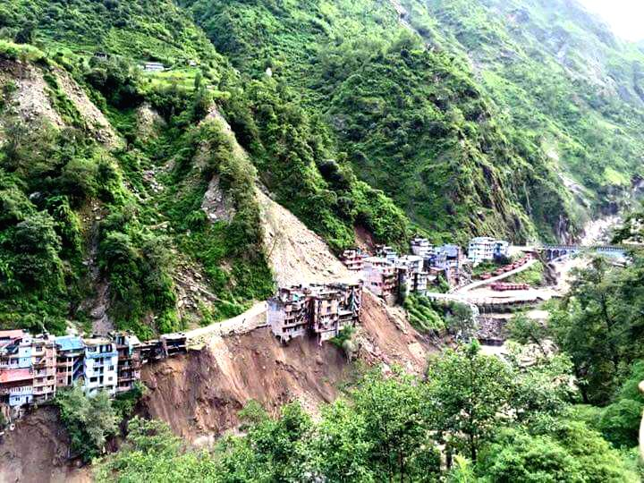 SINDHUPALCHOWK, July 6, 2016 - Photo taken on July 6, 2016 shows Nepalese houses near the Nepal-China border on risk due to landslides and blocked Bhotekoshi river at Tatopani, Sindhupalchowk, Nepal. ...