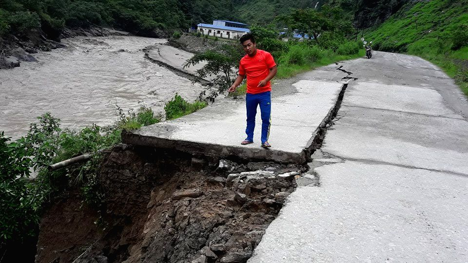 SINDHUPALCHOWK, July 6, 2016 - Photo taken on July 6, 2016 shows the damaged Araniko Highway due to landslides and blocked Bhotekoshi river at Tatopani, Sindhupalchowk, Nepal. More than 300 people ...