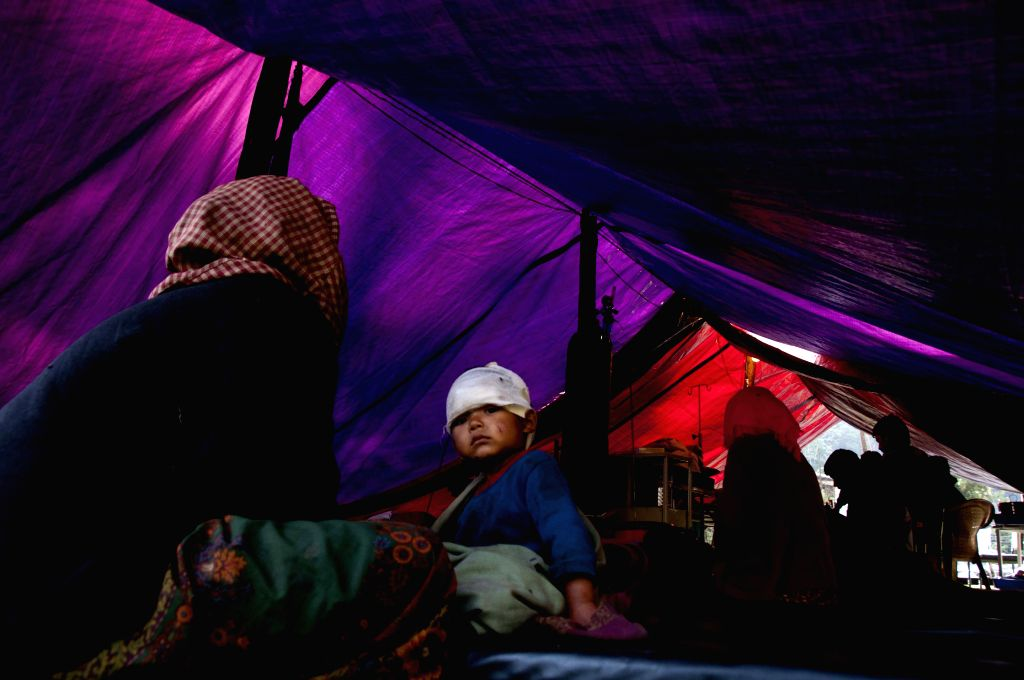 People take rest in a makeshift tent in Sindhupalchowk, Nepal, May 2, 2015. The death toll from last Saturday's powerful earthquake in Nepal reached 6,659 and ...