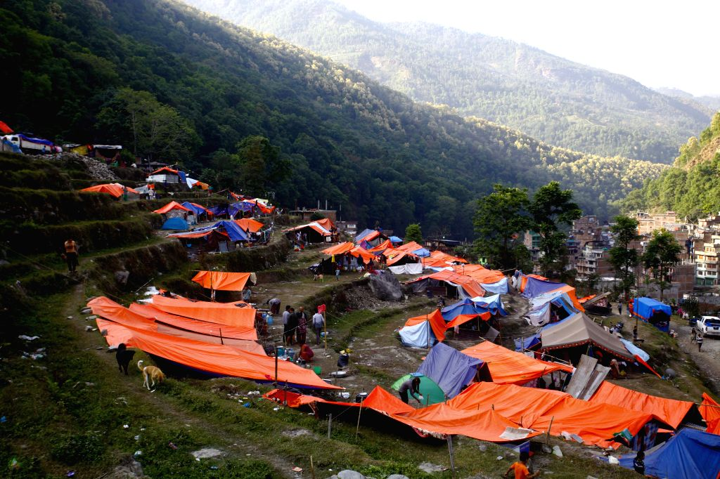 Picture taken on May 2, 2015 shows a scene of makeshift tents after the earthquake on April 25 in Sindhupalchowk, Nepal. The death toll from last Saturday's ...