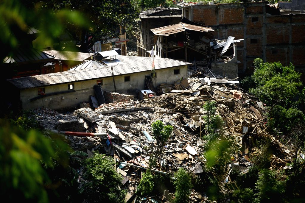 People work in the destructed houses at Sindhupalchowk, Nepal, on May 3, 2015. At least 7,040 persons were confirmed dead with the number of injured exceeding ...