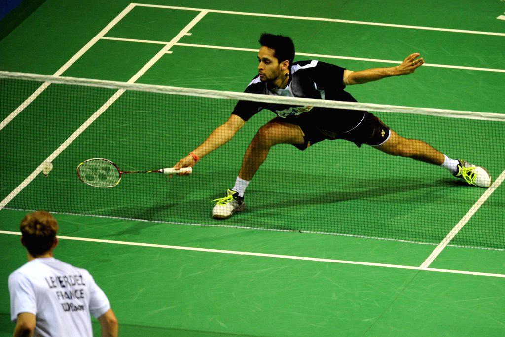 Kashyap Parupalli (R) of India competes during his men's singles quarterfinal match against Brice Leverdez of France at the 2015 OUE Singapore Open in Singapore, ...