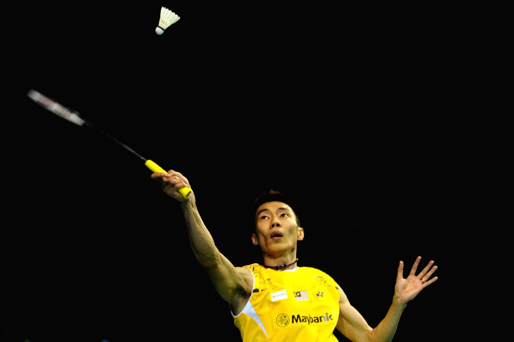 Lee Chong Wei of Malaysia competes during the men's singles quarterfinal match at the OUE Singapore Open badminton tournament against Tanongsak Saensomboonsuk of