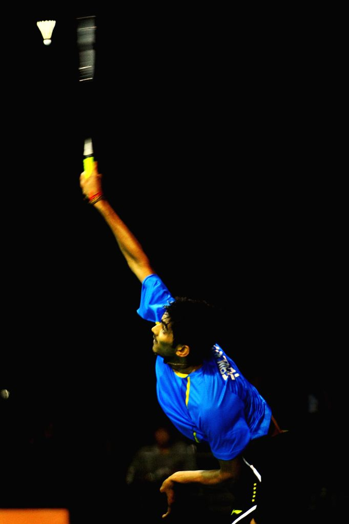 Srikanth of India competes during the men's singles quarterfinal match at the OUE Singapore Open badminton tournament against Hu Yun of Hong Kong of China in ...