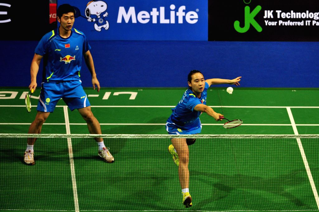Liu Cheng (L) and Bao Yixin of China compete during the mixed doubles semifinal match at the OUE Singapore Open badminton tournament against Tontowi Ahmad and ...