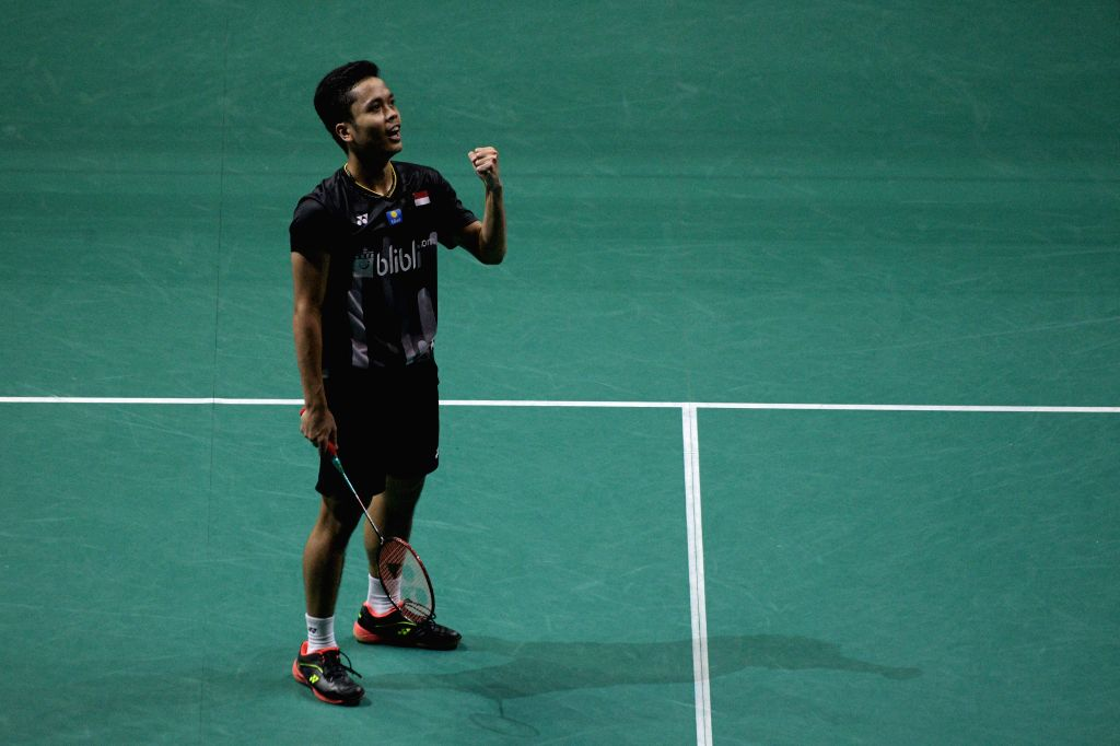 SINGAPORE, April 12, 2019 - Anthony Sinisuka Ginting of Indonesia celebrates after winning the men's singles quarterfinal match against Chen Long of China at Singapore Badminton Open in Singapore on ...