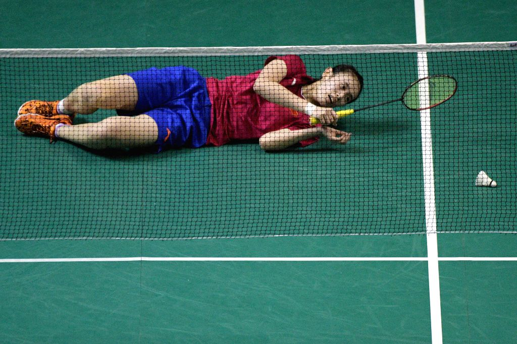 SINGAPORE, April 12, 2019 - Cai Yanyan of China reacts during the women's singles quarterfinal match against Pusarla V. Sindhu of India at Singapore Badminton Open in Singapore on April 12, 2019.