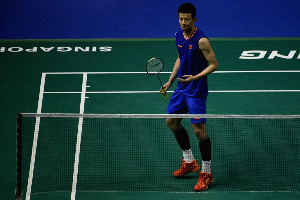 SINGAPORE, April 12, 2019 - Chen Long of China reacts during the men's singles quarterfinal match against Anthony Sinisuka Ginting of Indonesia at Singapore Badminton Open in Singapore on April 12, ...