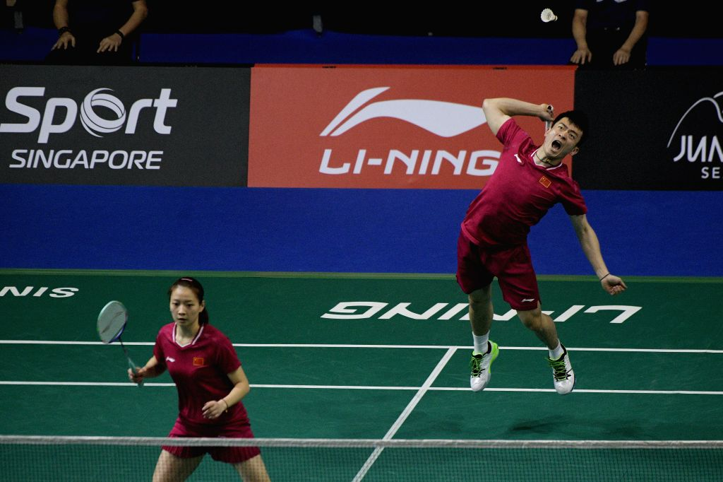 SINGAPORE, April 12, 2019 - Zheng Siwei(Top)/Huang Yaqiong of China compete during the mixed doubles quarterfinal match against Yuki Kaneko/Misaki Matsutomo of Japan at Singapore Badminton Open in ...