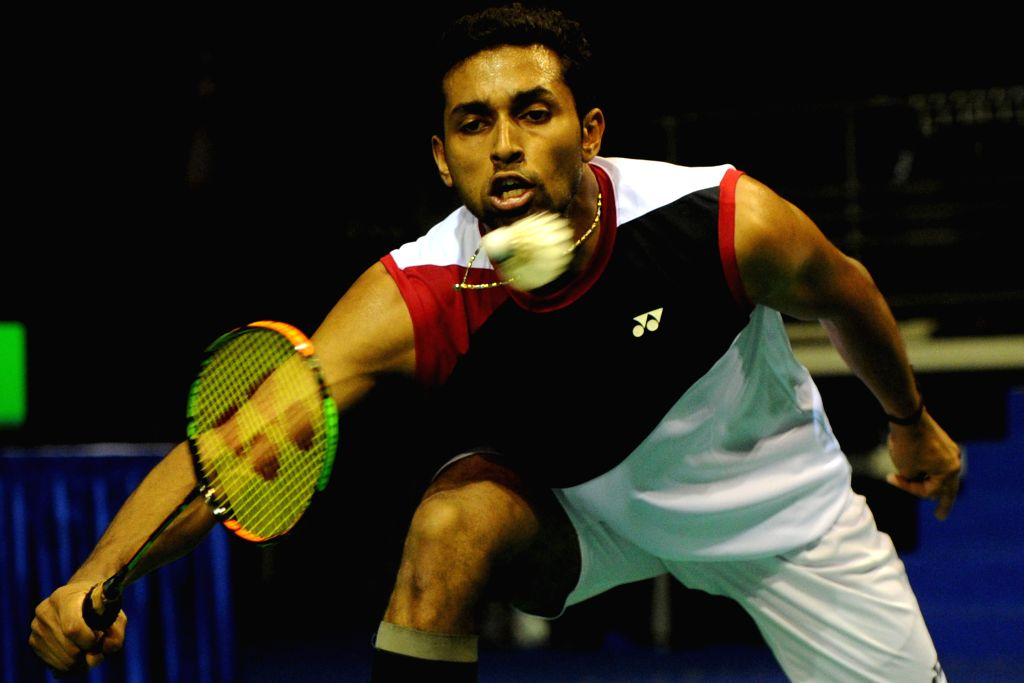 SINGAPORE, April 13, 2016 - India's H.S. Prannoy hits the shuttle cock during the OUE Singapore Open men's singles first round against China's player Chen Long held at Singapore Indoor Stadium on ...
